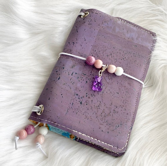 Field notes size natural cork notebook in purple, Kawaii style with gummy bear charm.  Inserts included