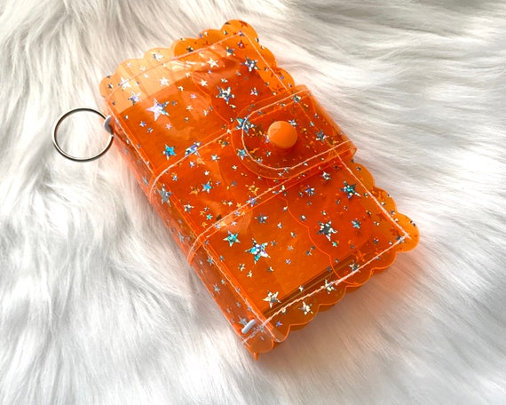 Take note!  Bright orange Star jelly clip-on mini travelers notebook TN complete with handmade inserts. It's sparkly cuteness to go!