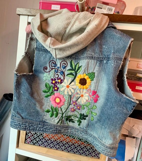 Beautiful floral design hand embroidered on upcycled denim vest with hood.  One of a kind, Women's Junior Large