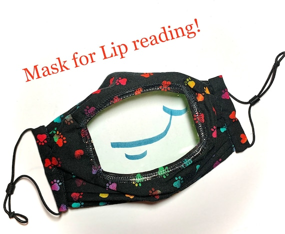 Black lip reading cloth face mask with clear vinyl window. Adjustable pleated cotton face mask shows the mouth to help with communication.