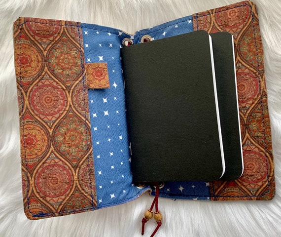 Field notes size TN traveler's notebook with bohemian printed natural cork accented with blue.  Artist made notebook includes inserts