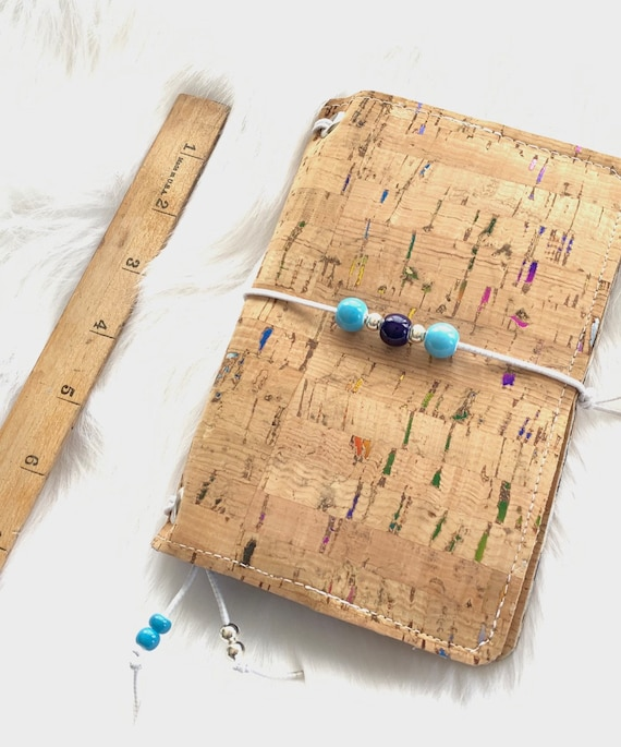 Field notes size TN natural cork traveler's notebook with rainbow foil flecks and coordinating beads. Artist made notebook includes inserts