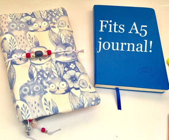 Delicate owl printed refillable A5 notebook in blue and pink.  Elastic bands for notebook inserts and a pocket for a hardbound A5 journal.