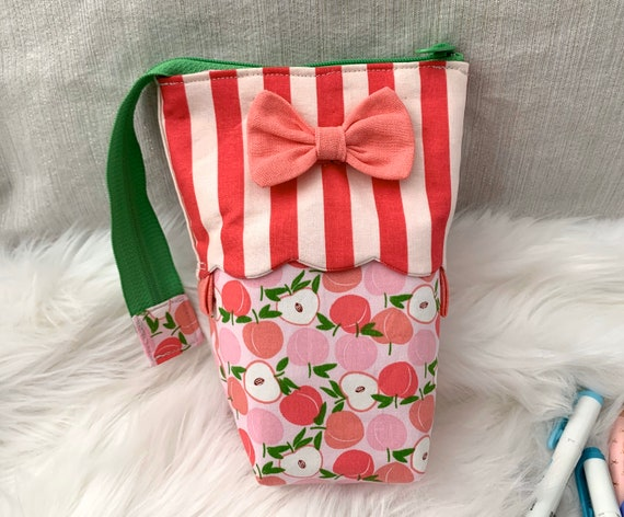 So clever! Brightly colored Kawaii standing sliding pen pouch with bold stripes, scalloped detail, and sweet bow.