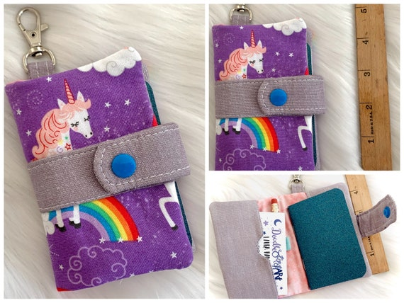 Take note!  Purple unicorn clip-on notebook card holder complete with adorably small blank notebook and pencil. It's cuteness, to go!