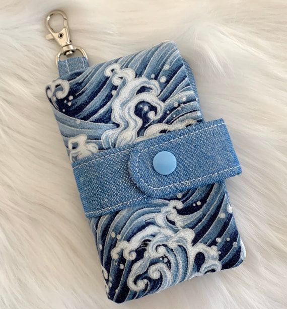 Take note!  blue wave print clip-on notebook card holder complete with adorably small blank notebook and pencil. It's cuteness, to go!