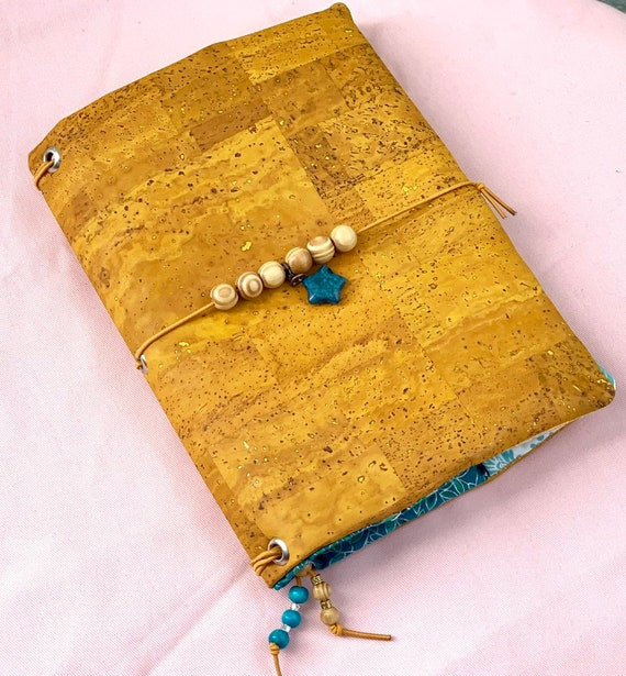 Refillable A5 cork notebook, rich mustard yellow color cork with coordinating fabric accents and pockets.  Inserts included.