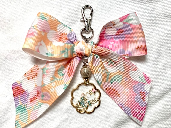 Blooming bow charm in cherry blossom ribbon and Japanese style enamel cat pendant. Unique eye candy to embellish your planner or bag!