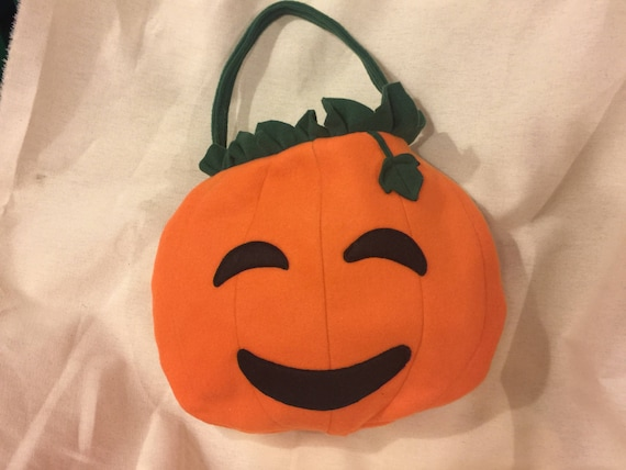 Cute pumpkin tote bag for Halloween trick or treat. Adorable fleece Jack o' lantern face adorned with leaves, fully lined