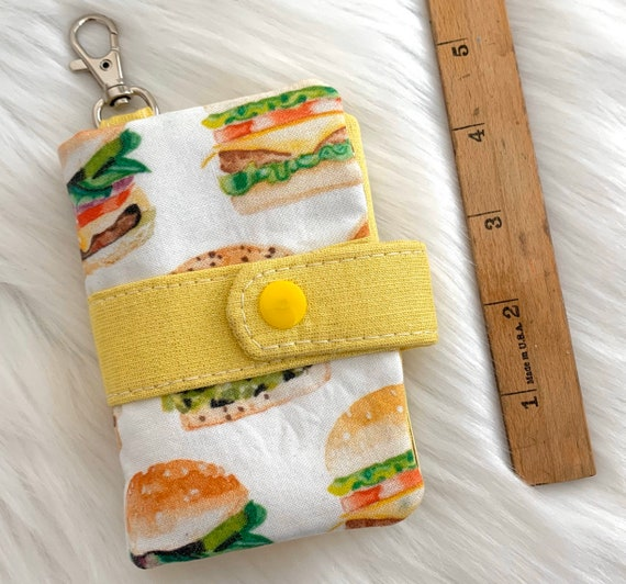 Take note!  Burger print clip-on notebook card holder complete with adorably small blank notebook and pencil. It's cuteness, to go!