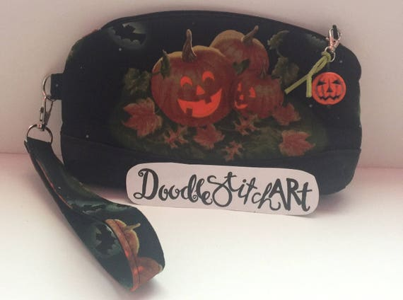 Halloween Jack o' lantern clutch or wristlet with pumpkin zipper pull charm