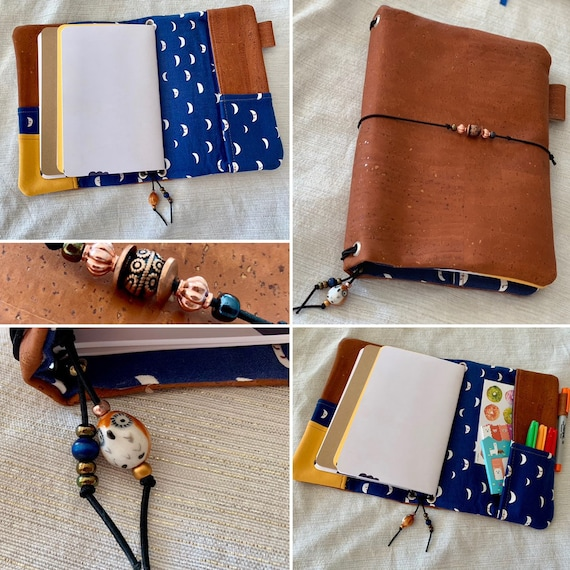Refillable A5 cork notebook, rich copper color with navy blue moon print fabric accents and pockets.  Inserts included!