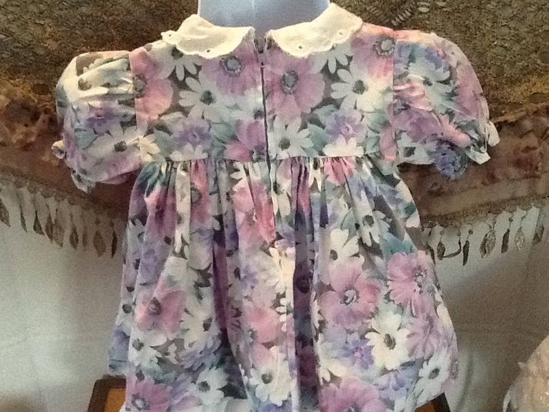 purple and green flowers for Easter or that cool spring or summer day. white filled with pink A beautiful bold coloured flowered dress
