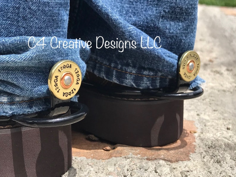 """3/8"""" 12 Gage Shotgun Shell Conchos on a set of our Signature Cuff Keepers   Unique Classy Functional Western Accessories"""