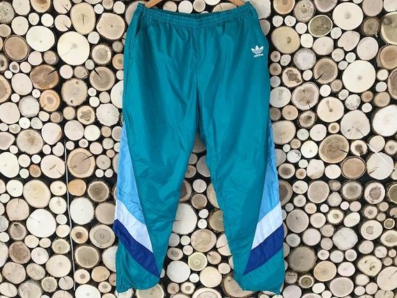 teal adidas track pants
