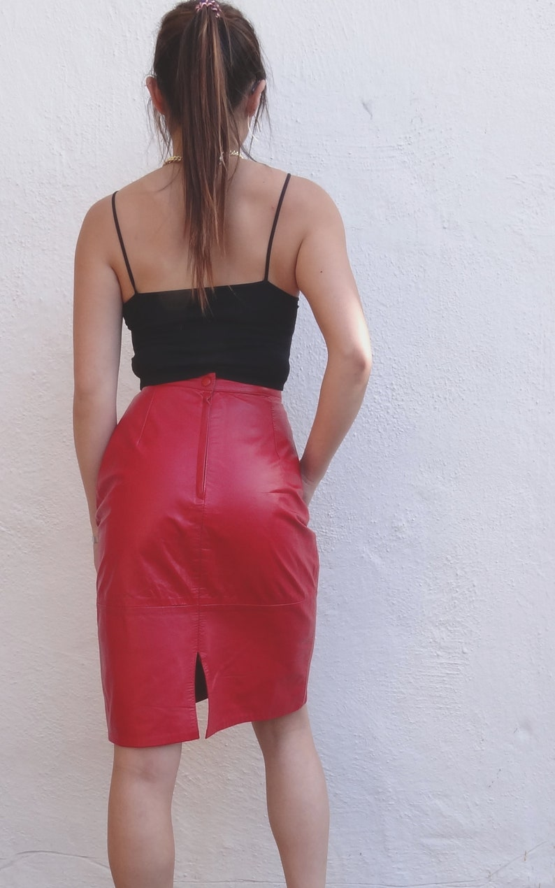 e5179733f Vintage red leather skirt // bright red leather midi skirt // | Etsy