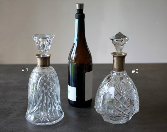 Two crystal glass decanter with silver collar (stamped three towers)