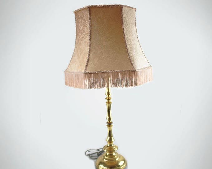 Vintage brass lamp with light rose lamp shade