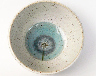 small bowl with puss flower