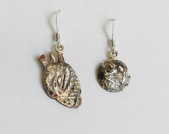 fac8baf49 Human heart copper and silver dangle earrings, odd pair circle, brutalist,  molten mixed metals, deterioration design, contemporary jewelry