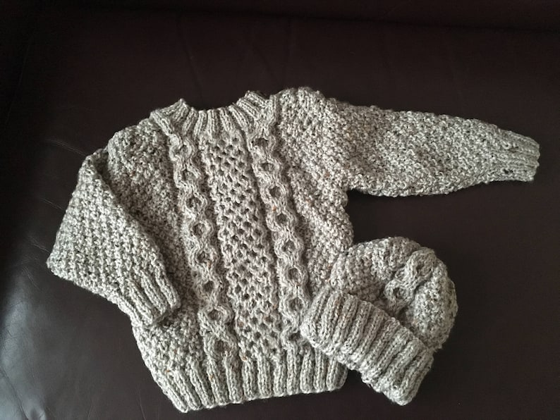 4de88711d Hand knitted cable jumper and hat