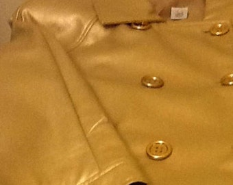 Double sided Gold leather blazer with 6 bouttons in the front and 2 pockets