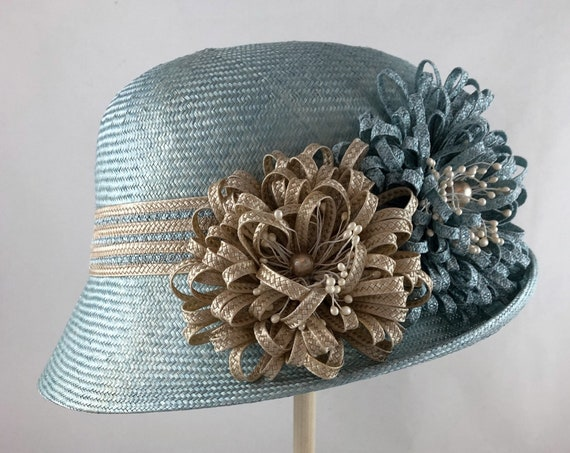 Light blue straw cloche with striped straw braid band and straw braid flowers