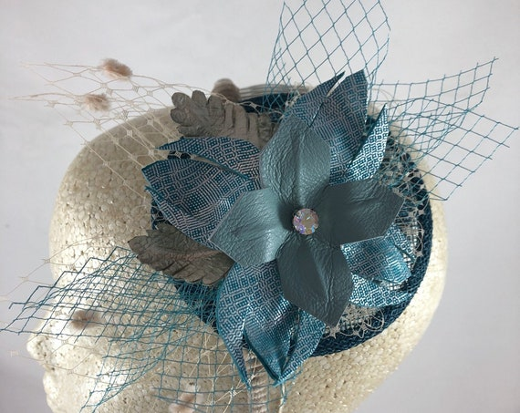 Aqua blue and silver leather flower fascinator