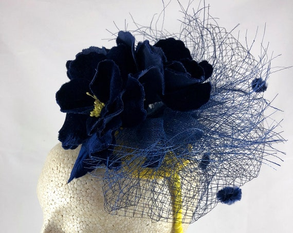 Navy blue vintage velvet flowers fascinator with navy vintage chenille dot veiling and blue sinamay fringe on yellow base with yellow band