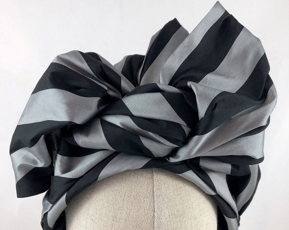 Black and gray striped taffeta turban hat with pink silk lining