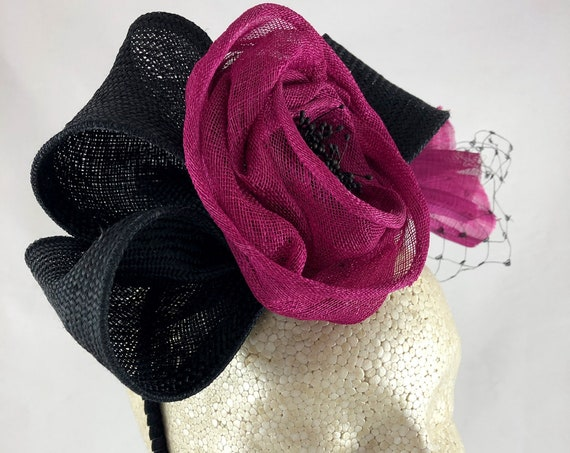 Black straw fascinator with hot pink sinamay rose, silk abaca fan, and vintage black silk veiling
