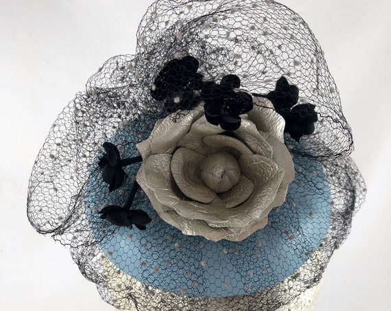 Light blue leather button hat with silver leather rose, vintage dot veiling and tiny black vintage flowers