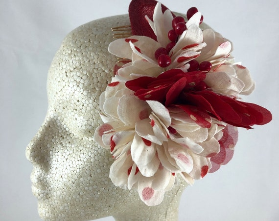 Cream and red polka dot flower comb on red sinamay crescent