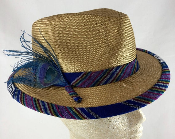 Modern gold straw fedora with multicolor striped cotton band and brim edge and dyed peacock feather
