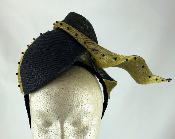 Two-color sinamay cocktail perching hat with glass beading on black headband