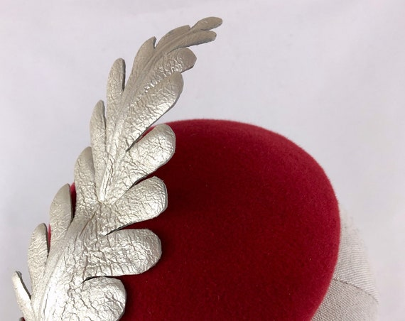 Red velour felt button hat with silver leather leaf embellishment