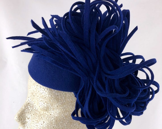 Cobalt blue felt perching hat with dramatic cut felt trim and braided bandeau