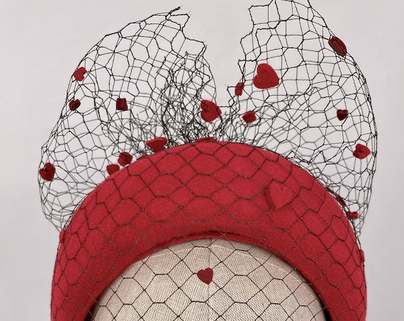 Red velour felt crown with vintage silk veiling and hand-cut leather and felt hearts
