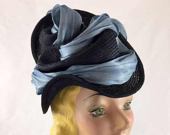 Black straw perching hat with blue silk abaca embellishment