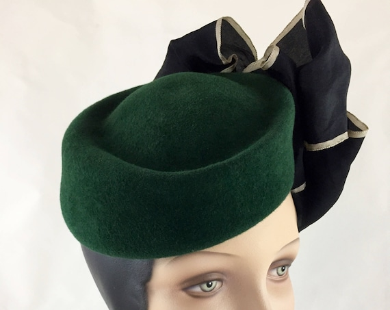 Forest green velour felt tilted pillbox hat with antique silk ribbon and metallic leather rose