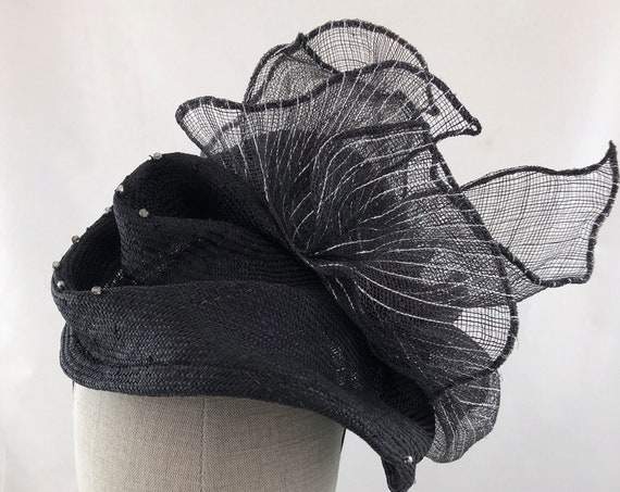 "Black hand-shaped straw cocktail hat with beading and silver lurex striped sinamay ""bow"""