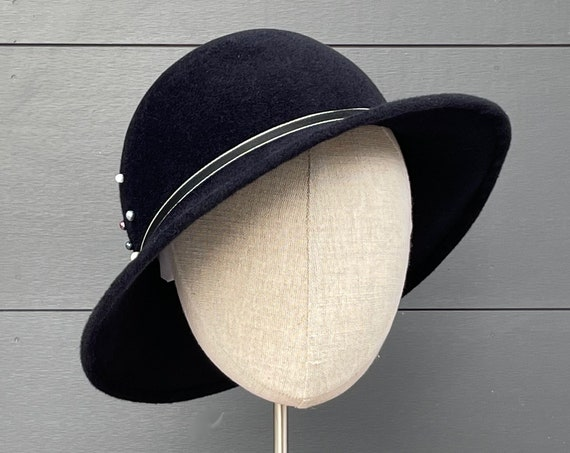 Black velour felt hat with antique ribbon, freshwater pearls, and downturned brim