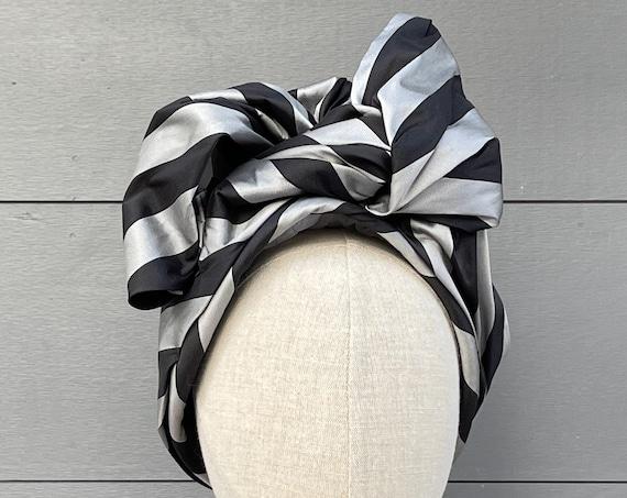 Black and gray striped taffeta turban hat with pink silk lining