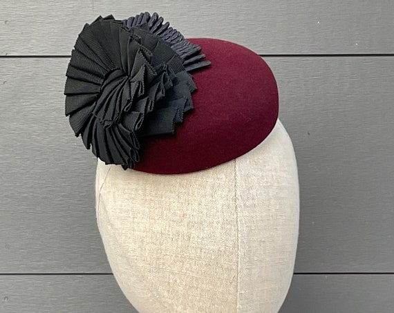 Burgundy felt cocktail hat percher with freeform ribbon cockades and ribbon bandeau
