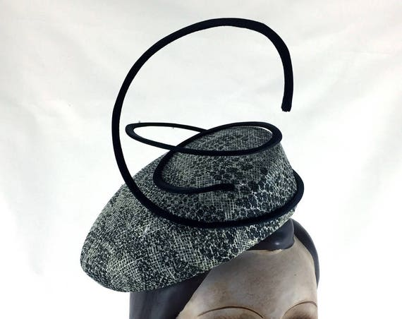 Snake-print straw perching hat with wired rouleau embellishment