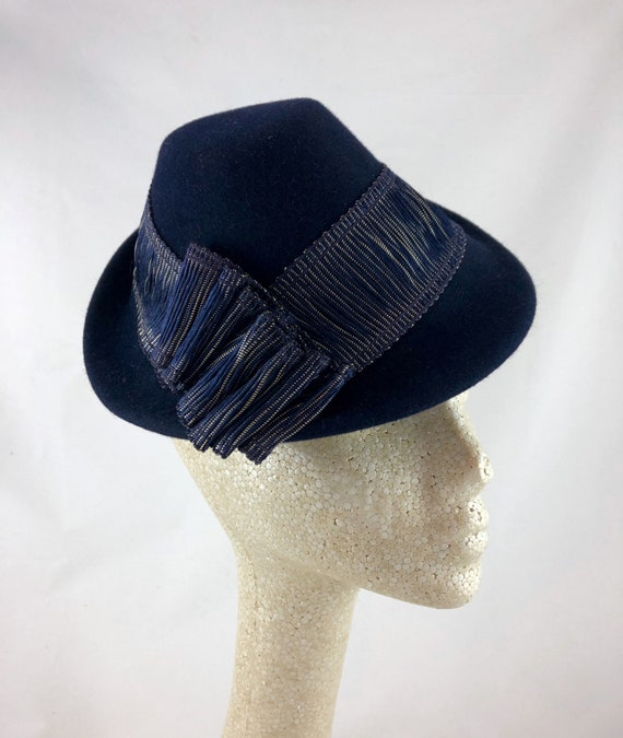 Navy blue velour felt perching hat with antique blue and metal ribbon band and ornament