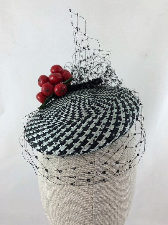 Black and white patterned cocktail hat with vintage cherry cluster and black silk veiling