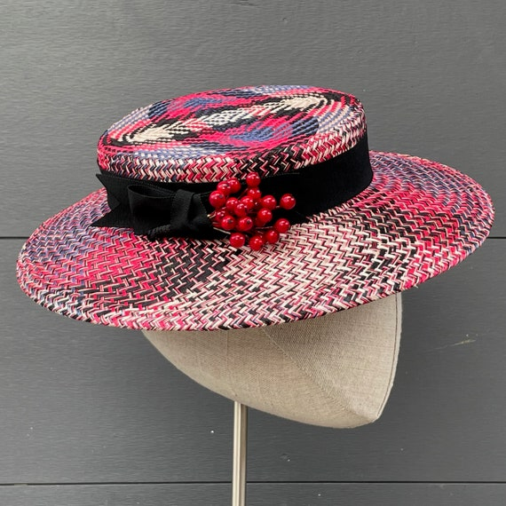 Multicolored buntal straw boater hat with black ribbon band and vintage red currants
