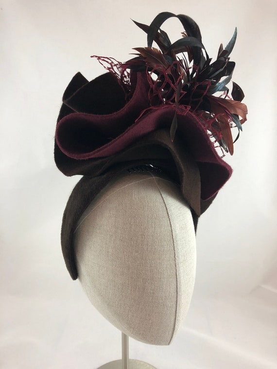 Burgundy and brown sculpted felt hat with vintage veiling and coque feather spray