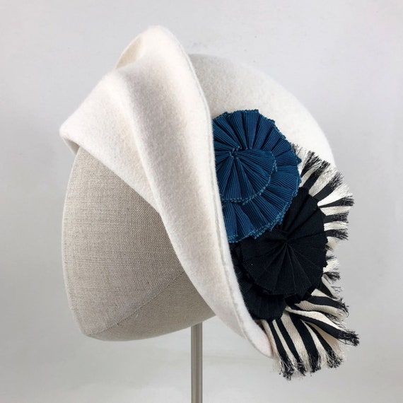 Hand-shaped winter white velour felt cloche with striped silk and ribbon cockades